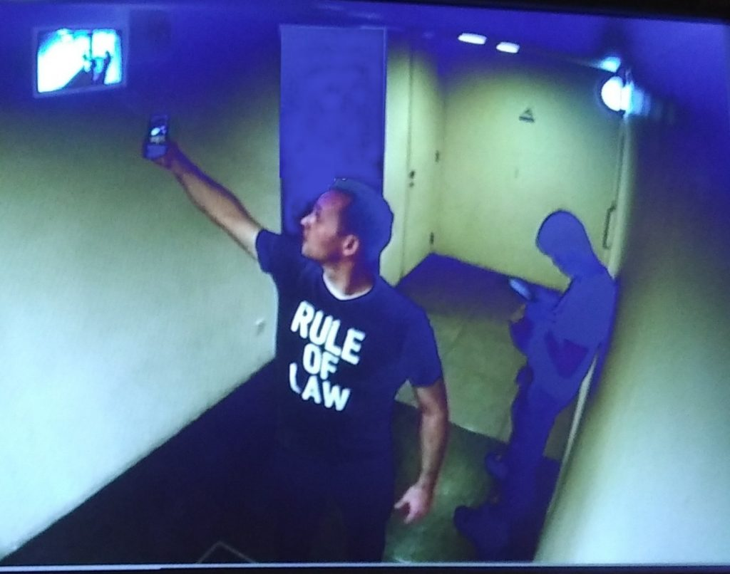 Patrick Dahm (emergency arbitrator, among other things) caught by a CCTV camera taking a picture of himself on the CCTV screen